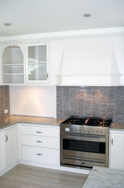 Killcare stove and splash back with cabinetry